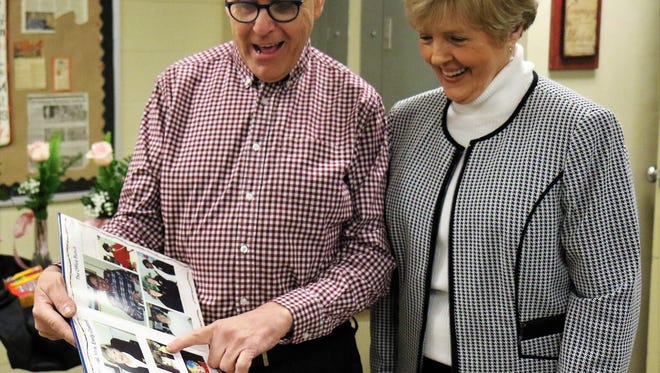 Bill Walker and Emily Crabtree reminisce about special memories while looking at a yearbook from Pope Elementary School during a reunion held Feb. 16, 2018, at the First United Methodist Church Activity Center in downtown Jackson.