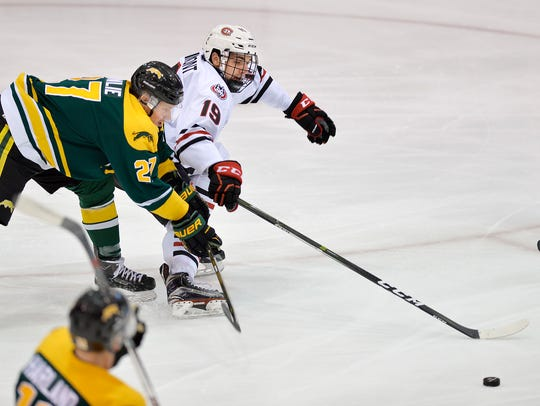 St. Cloud State's Mikey Eyssimont, right,  battles