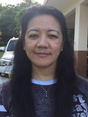 Cynthia Manibusan, of Dededo, almost had her purse