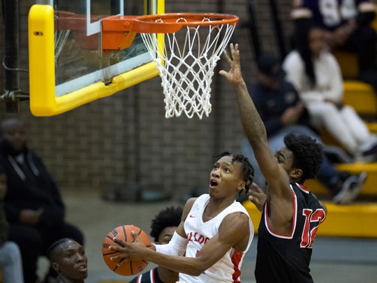 Bosse's Mekhi Lairy (2) shoots against Harrison's Erik Smallings-Thomas (12) and scores for his 25th point during the SIAC Championship game at Central High School Saturday night, Jan. 13, 2018. The basket moved him into second place on the all-time scoring list in the city.