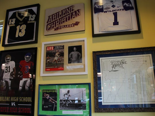 A wall at Raising Cane's restaurant is filled with
