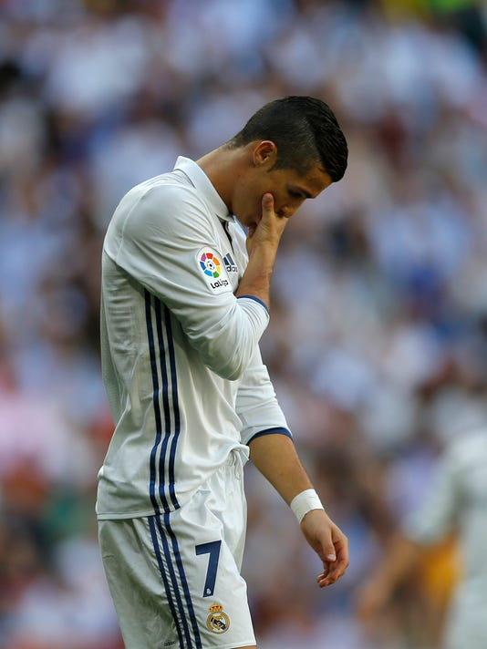 Real Madrid's Cristiano Ronaldo looks down during the Spanish La Liga soccer match between Real Madrid and Eibar at the Santiago Bernabeu stadium in Madrid, Sunday, Oct. 2, 2016. The match ended in a 1-1 draw. (AP Photo/Francisco Seco)