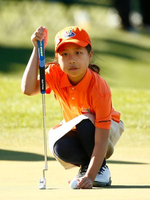 Maye Huang lines up her putt in the Girls 7-9 age group during the Drive, Chip and Putt National Finals at Augusta National Golf Club on April 2.