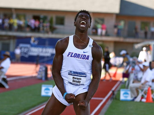 Florida's Marquis Dendy, a Middletown High graduate, celebrates on his last jump after winning the triple jump during the NCAA track and field championships Friday in Eugene, Ore.