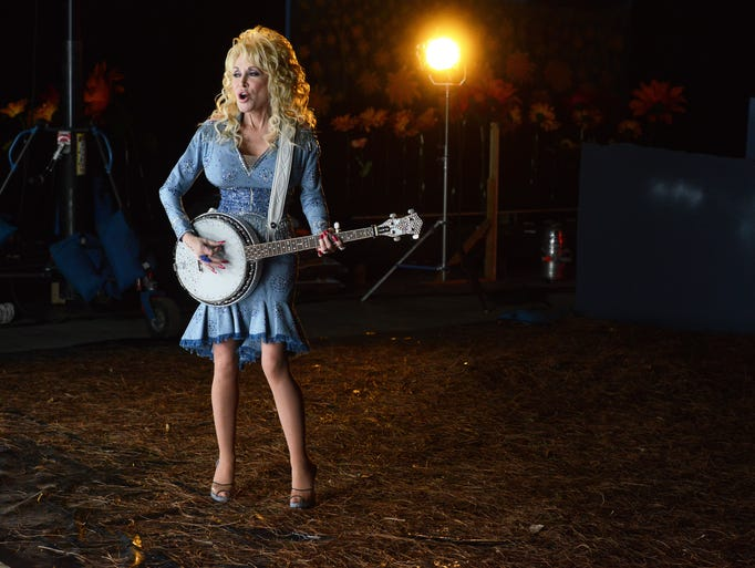 """Country music legend Dolly Parton performs in a scene for a music video for her song """"Home"""" Thursday, April 17, 2014, in Nashville, Tenn."""