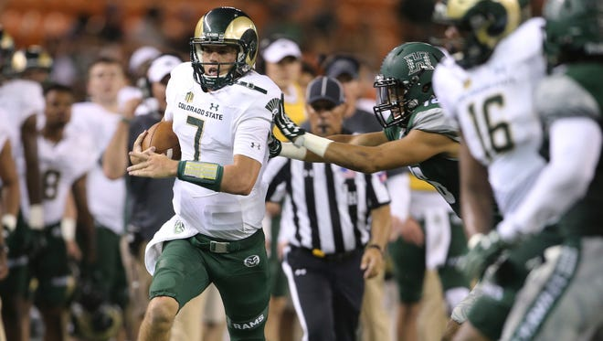 CSU quarterback Nick Stevens is forced out of bounds by a Hawaii defender during a Sept. 30 game in Honolulu. The Rams could wind up playing at Aloha Stadium again on Christmas Eve, as the Mountain West's representative in the Hawaii Bowl.