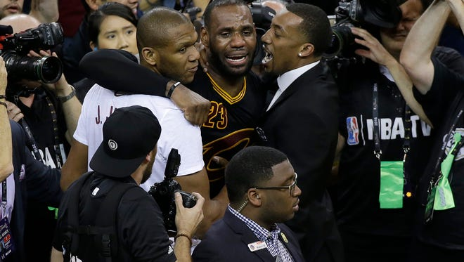 Cleveland Cavaliers forward LeBron James, center, celebrates after Game 7 of basketball's NBA Finals between the Golden State Warriors and the Cavaliers in Oakland.