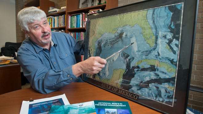 Professor Bill Huth points out the artificial reefs in the Gulf of Mexico during a discussion at his office at the University of West Florida in Pensacola on Monday, March 6, 2017.  UWF has produced a new online class series highlighting the history and economy of the Gulf of Mexico.
