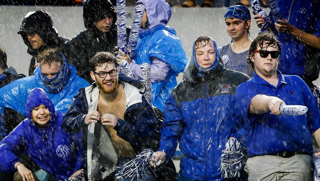 University of Memphis fans brave the heavy rains and winds that pour down inside the Liberty Bowl Memorial Stadium before the Tigers first football game of the season against Louisiana-Monroe, Thursday evening.