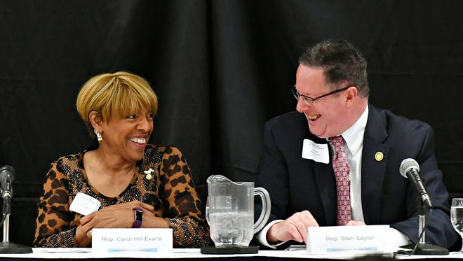 Rep. Carol Hill-Evans, of the 95th House District, left, and Rep. Stan Saylor, of the 94th House District speak acknowledge their differences during the Legislative Panel Discussion on the State Budget as the York County Economic Alliance hosts its Spring Legislative Luncheon at Wyndham Garden York in West Manchester Township, Thursday, May 17, 2018. Dawn J. Sagert photo