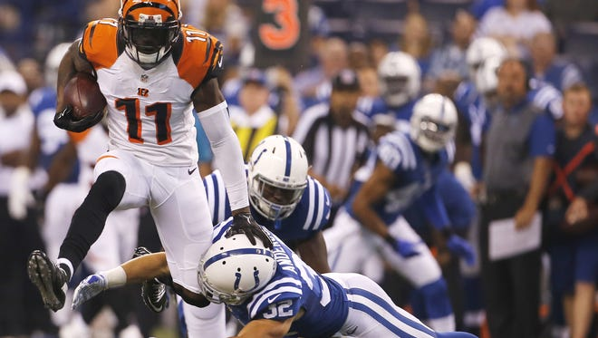 Bengals wide receiver Greg Little makes a catch and leaps over Colts free safety Colt Anderson in the first quarter during the preseason NFL game between the Cincinnati Bengals and Indianapolis Colts, Thursday, Sept. 3, 2015, Lucas Oil Stadium in Indianapolis.