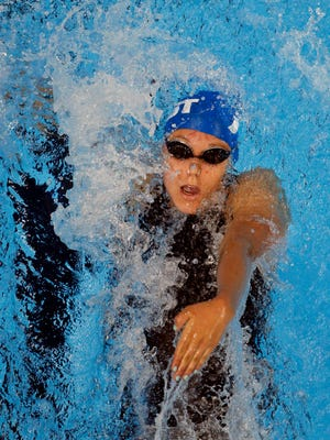 Fossil Ridge's Bayley Stewart swims in the women's 100 backstroke preliminary heats in the U.S. Olympic swimming team trials at the CenturyLink Center on Monday in Omaha, Neb.