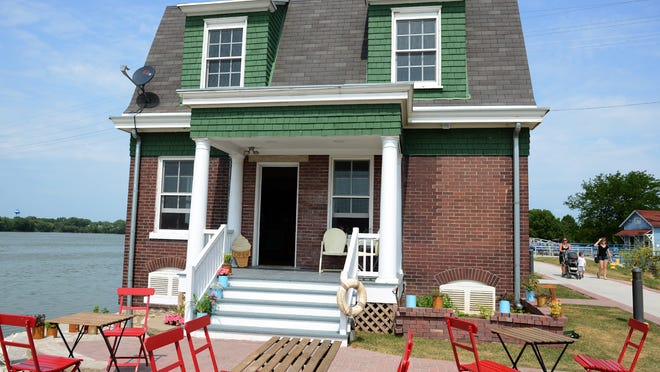 In its first summer, the Locktender's House has been drawing visitors of all ages looking for an iced coffee, a snack or just a spot to take in the Fox River views.