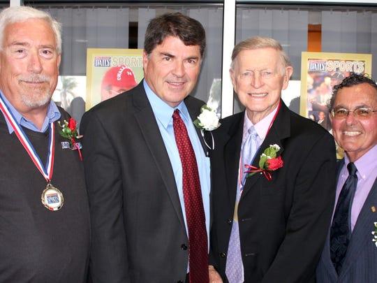 Hall of Famer Mark Decotis, left, along with inducteed Jeff Carr, Hall of Famer Tom Wasdin and inductee Hillard Grossman.