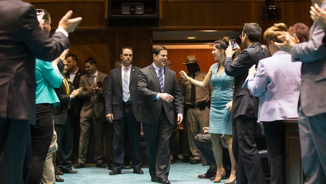 Gov. Doug Ducey is introduced before delivering his first State of the State address in the House chambers in January 2015.