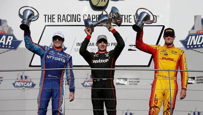 IndyCar GP winner Will Power,middle, 2nd place Scott Dixon,left, and 3rd place finisher Ryan Hunter-Reay,right, hold their trophies following the IndyCar Grand Prix Saturday, May 13, 2017, afternoon at the Indianapolis Motor Speedway.