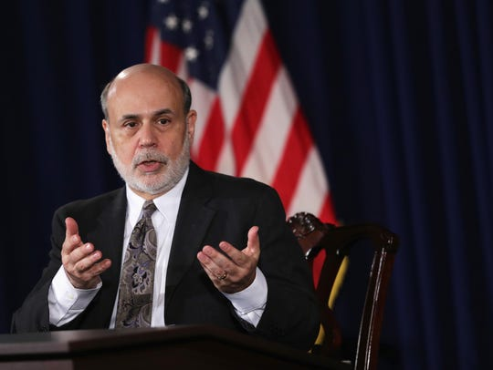 WASHINGTON, DC - DECEMBER 18:  Federal Reserve Board Chairman Ben Bernanke speaks during a news conference after a Federal Open Market Committee (FOMC) meeting December 18, 2013 at the Federal Reserve in Washington, DC. The Federal Reserve has announced that it will scale back its U.S. Treasury bonds and mortgage-backed securities buying program to $75 billion each month.  (Photo by Alex Wong/Getty Images) *** BESTPIX ***