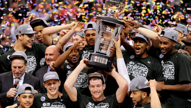Michigan State senior forward Matt Costello (10) holds the Big Ten Championship trophy as confetti falls and the team after MSU's 66-62 win over Purdue after the Big Ten Tournament Championship game, Sunday, March, 13, 2016 at Bankers Life Fieldhouse in Indianapolis.