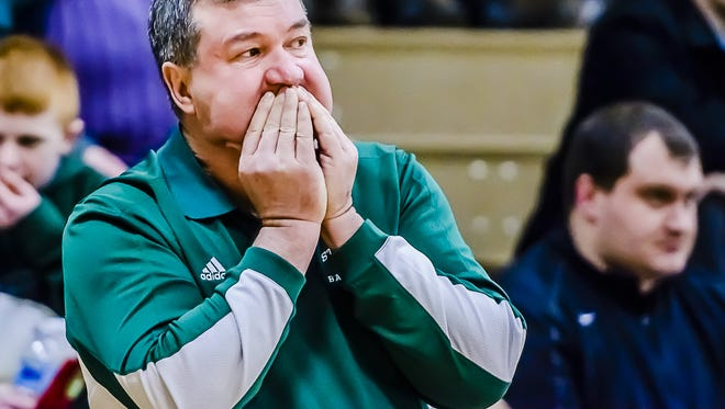 Portland St. Patrick's Girls Basketball Head Coach Al Schrauben reacts after a foul is called on one of his players late in the first half of the Shamrocks' game with Laingsburg on Jan. 20, 2015