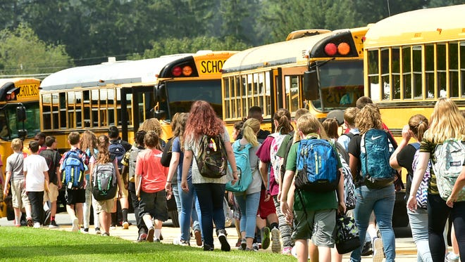 Students look for their school buses following the first day of classes after summer break at Chambersburg Area Middle School South.