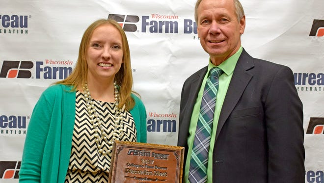 Mishicot High School agriscience teacher Jamie Propson (left) won the 2017 Wisconsin Farm Bureau Federation Young Farmer and Agriculturist Discussion Meet Dec. 3 in Wisconsin Dells.