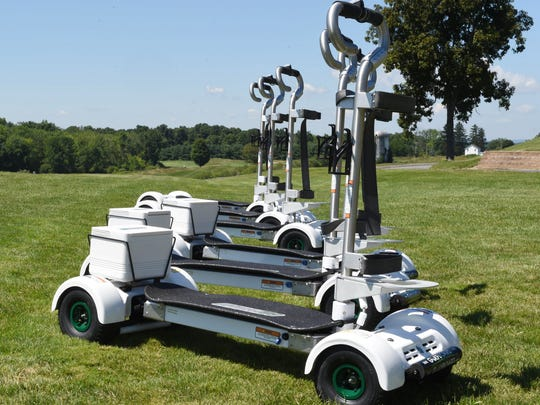 A line of GolfBoards at The Links at Union Vale on Wednesday. GolfBoards are single person four wheeled stand up carts that allow golfers to ride virtually anywhere on the course they need.