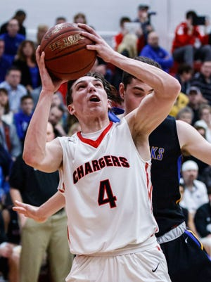 Hamilton sophomore Lucas Finnessy (4) gets a look under the hoop during the WIAA level 1 regional game at home against Germantown on Friday, March 2.