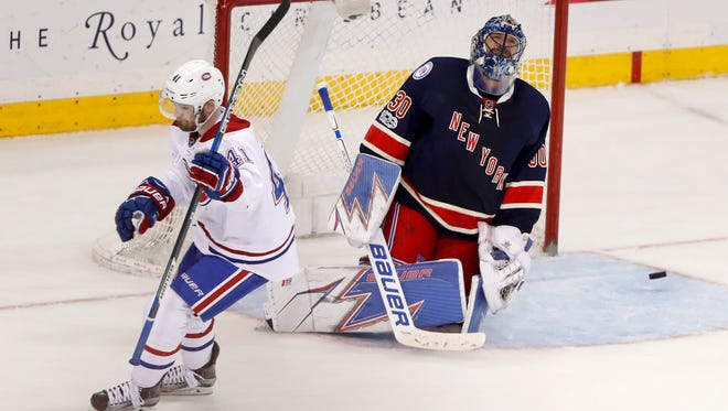 New York Rangers goalie Henrik Lundqvist (30) reacts after Montreal Canadiens left wing Paul Byron (41) scored in the shootout of an NHL hockey game, Tuesday, Feb. 21, 2017, in New York. The Montreal won 3-2.