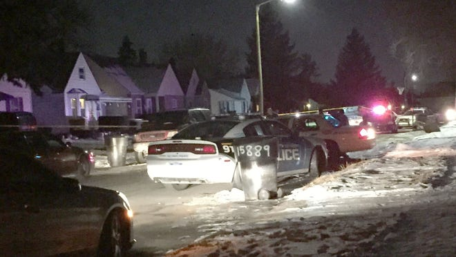 Detroit police at the scene of a shooting death of a teen in the 15800 block of Lappin Street in Detroit on Tuesday, Jan. 27, 2015.