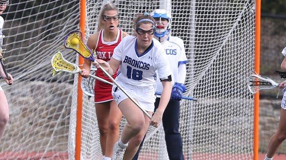 Bronxville's Allie Berkery (18) carries the ball against
