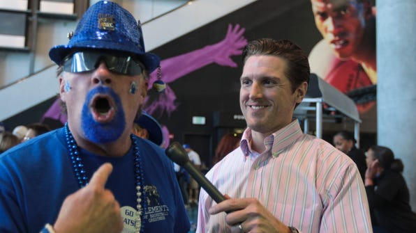 C-J's UK beat reporter Kyle Tucker talks with Kentucky fan Doug Willoughby of Paducah during a pep rally at the SEC Tournament in Atlanta this year.