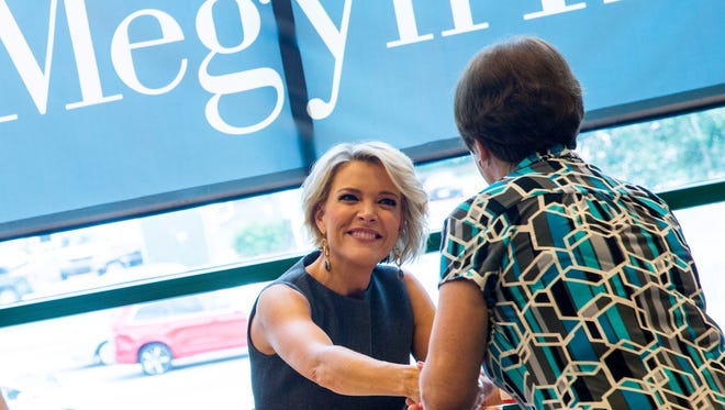 Fox News Channel journalist Megyn Kelly shakes hands with a fan during a book signing event for her memoir titled Settle for More at the Barnes and Nobles in Naples, Florida on Thursday, Nov. 1, 2016.