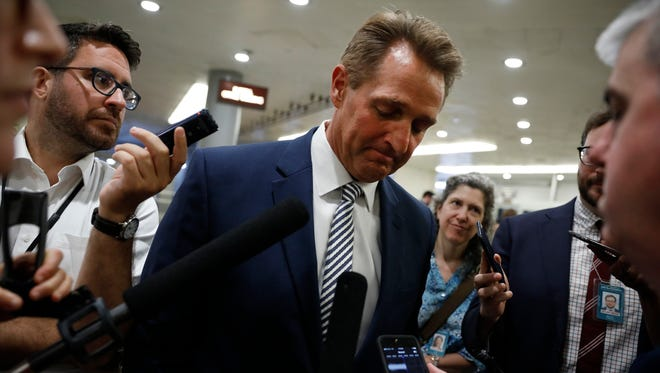 """Sen. Jeff Flake, R-Ariz. """"I never thought I would see the day when our American President would stand on the stage with the Russian President and place blame on the United States for Russian aggression. This is shameful."""""""