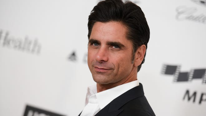This April 25, 2015, file photo shows actor John Stamos arriving at the 4th Annual Reel Stories, Real Lives Benefit in Los Angeles. Stamos has been arrested and cited with driving under the influence in Beverly Hills. Beverly Hills police say they received calls around 7:45 p.m. Friday, June 12, 2015, reporting a possible drunk driver.