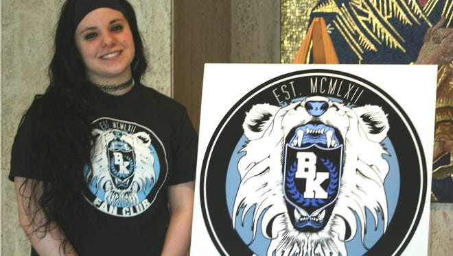 Bishop Kearney senior Cassie Powchowicz with the logo she designed and has been adopted for the school's sports teams.