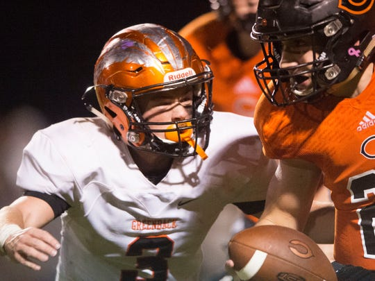 Coalfield's Parker McKinney is pressured by Greeback's Bryce Hanley on Thursday, October 5, 2017.