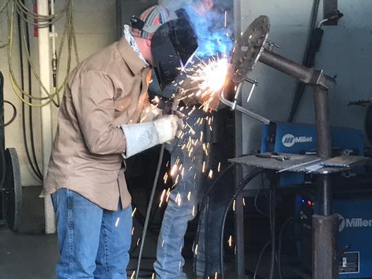 Zachary Sutton, of Abilene, makes the sparks fly during a welding class at Cisco College Thursday, April 12, 2018.