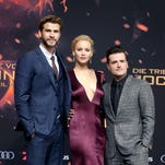 For 'Hunger Games' star Jennifer Lawrence, saying goodbye to co-stars Liam Hemsworth (left) and Josh Hutcherson was arguably her toughest assignment.