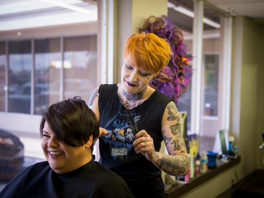 Salon Absinthe founder Scarlet Strange, right, cuts Ginger Rutherford's hair at her salon April 4, 2017. Salon Absinthe will no longer base its pricing on gender and now charges based on hair length and cut complexity.