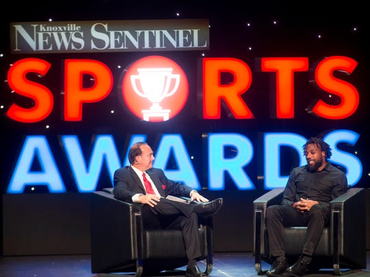 Dr. Jerry Punch talks with Eric Berry during the News Sentinel Sports Awards at the Tennessee Theatre on Wednesday, June 7, 2017.