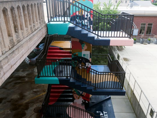 """Stories"" is a public art piece that features 41 Knoxville-related references and was installed on a staircase leading to West Jackson Avenue from Gay Street. The mural was designed by Eric Vass of Robin Easter Design."