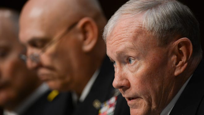 Gen. Raymond Odierno, left, and Gen. Martin Dempsey both held combat commands before rising to four-star rank in the Army.