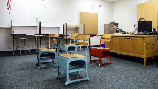 Old desks sit in the suspension room at the 94-year-old Whittier Middle School which has no room for additions and features small classrooms. With the school district releasing a new master facilities plan later this year the building's future is uncertain.