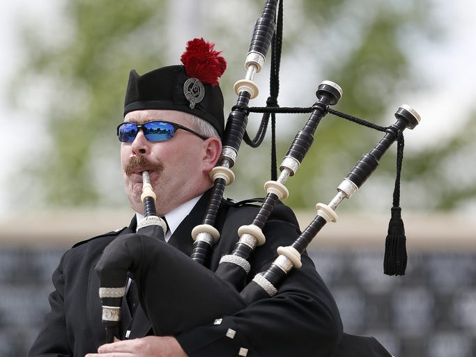 Shrine bagpiper Jessie Calender plays the bagpipes at a Memorial Day service at the Montana Veterans Memorial Monday.
