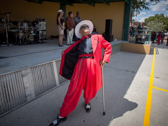 A participant in the Zoot Suit contest poses for the crowd during the first ever Zoot Suit Pachanga at Klein Park, June 4, 2016.