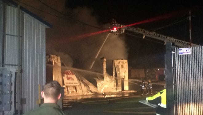 Crews fight a fire at Hanifen Towing in Saylor Township on Thursday night.