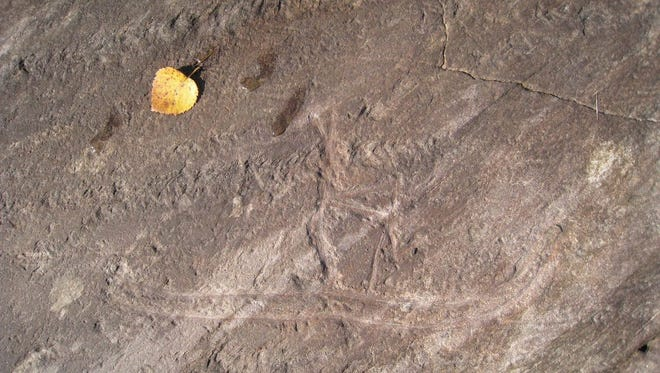 An undated handout picture provided by the Nordland County shows the 5,000-year-old rock carving 'skiier' at a historical sight in Tro, Nordland, Norway, before it was damaged.