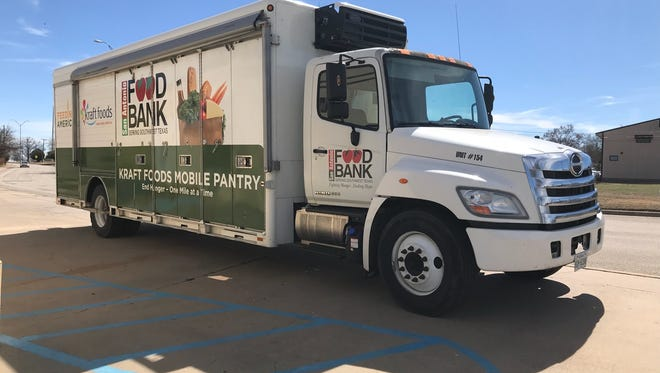 A mobile food pantry truck, donated by San Antonio Food Bank for the Wichita Falls Area Food Bank, now waits for enough funds to fill it.