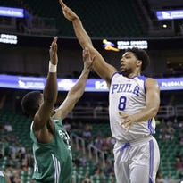 Philadelphia 76ers' Jahlil Okafor (8) shoots as Boston Celtics' C.J. Fair, left, defends during the first half of an NBA summer league basketball game Tuesday.