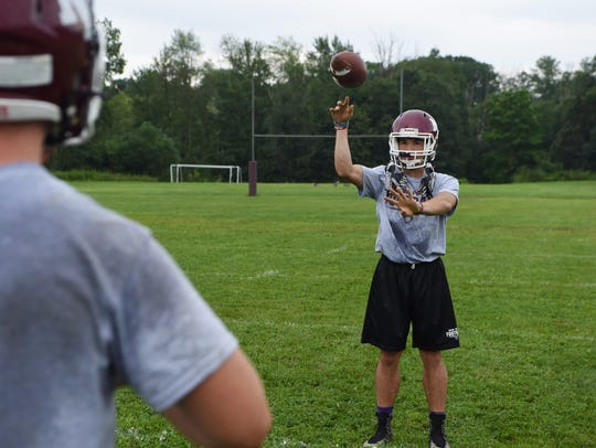 New Paltz's Axel Rodriguez, right, throws a pass to